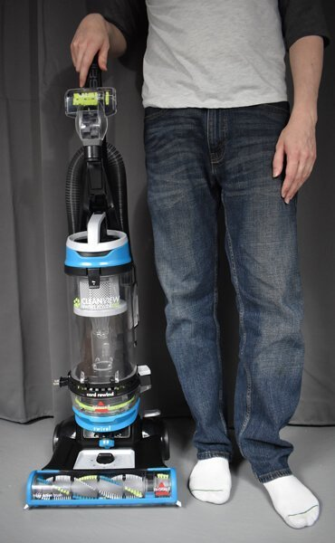 bissell cleanview 2254 beside a person