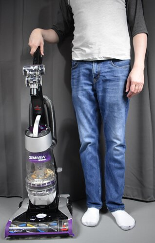 Bissell Cleanview 1819 beside a person