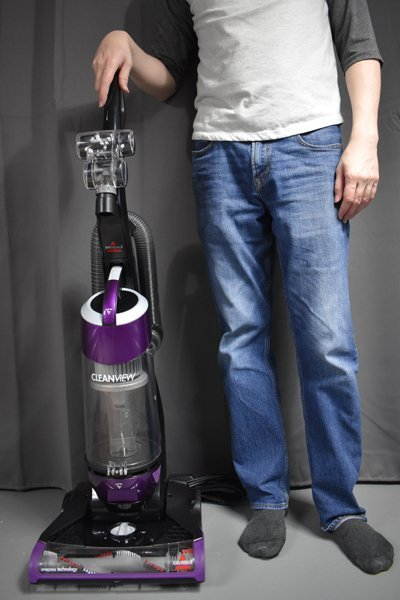 Bissell CleanView Plus 1822 beside a person