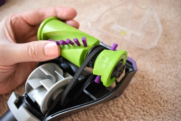 Remove any debris or tangled hair from the brushroll or surrounding parts