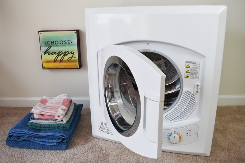 Panda Portable Laundry Dryer beside dry towels