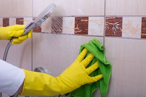 cleaning shower tiles using a cloth