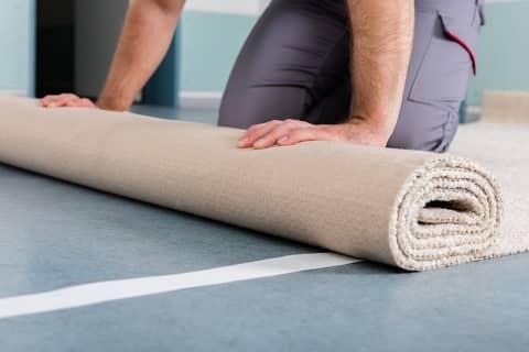 installing rug on linoleum floor