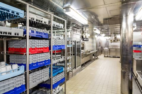 commercial kitchen with cleaned dishes
