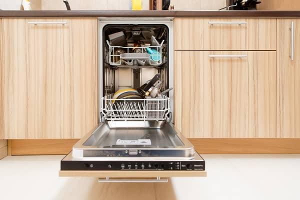 dishwasher open with dishes inside