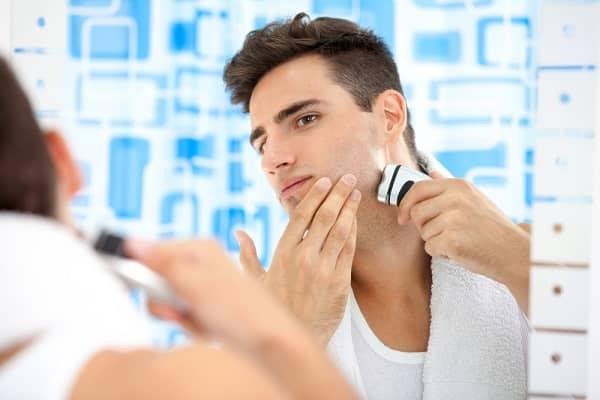 young man shaving with Braun series 8 razor