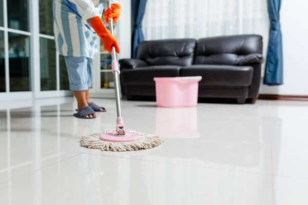 woman using a spin mop